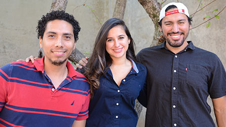 three dental students who traveled to Honduras pose with arms over each others shoulders