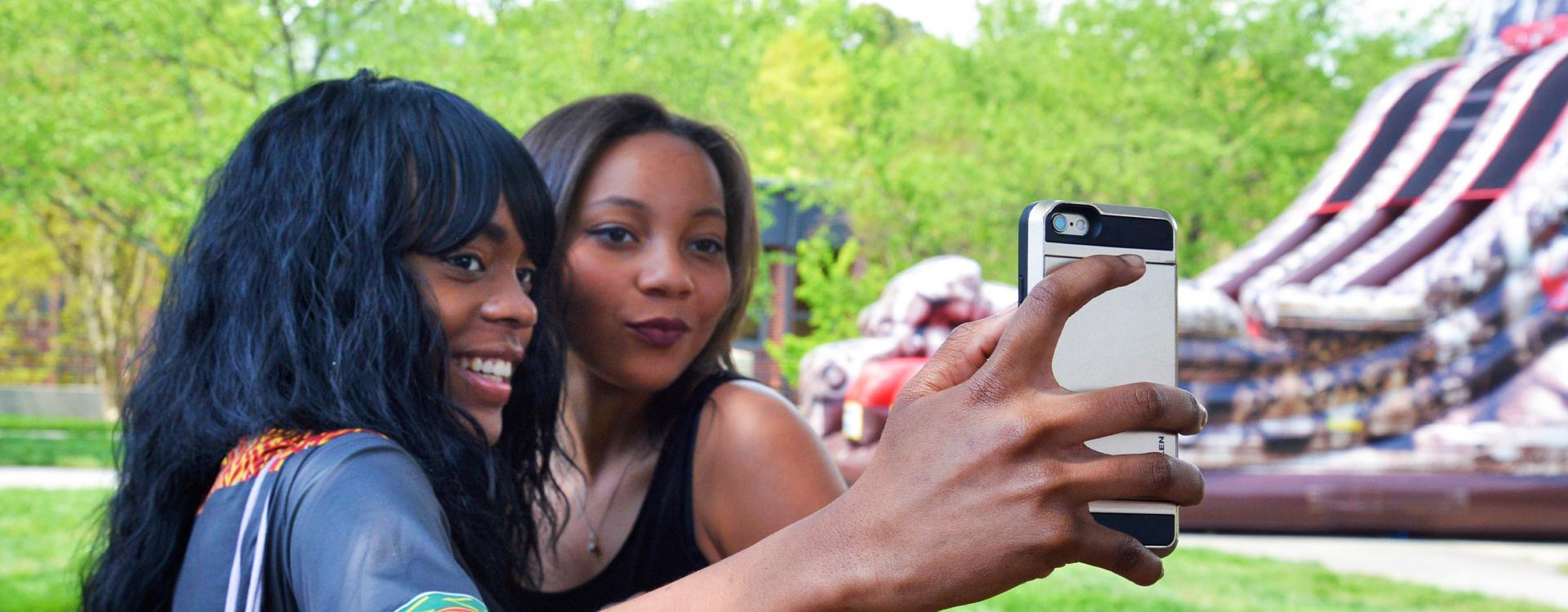 female students take selfie at student event